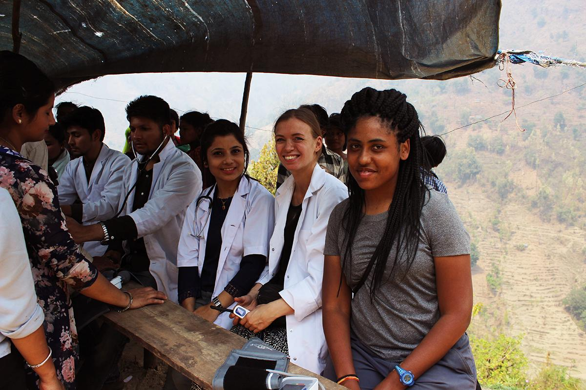 A group of interns assist at a healthcare outreach on our medical internship for teenagers in Nepal